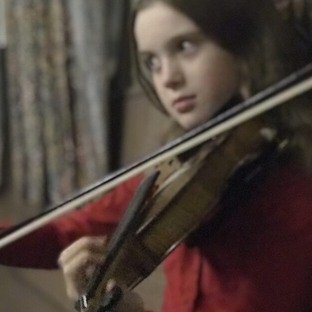 Lucy playing violin closeup
